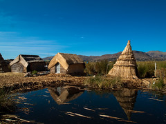 Houses of Los Uros, Titicaca, Peru (creditflats) Tags: blue houses sky lake reflection peru uros titicaca los floating read clear tipi puno