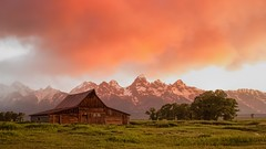 cloudy sky at sunrise - Moulton Barn (Marvin Bredel) Tags: morning red sky clouds barn sunrise wyoming tetons jacksonhole topaz redcloud moulton oldwest grandtetonnationalpark marvinbredel