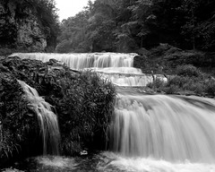 the rush (tayl0439) Tags: park bw white motion black mamiya nature water wisconsin river waterfall midwest slow natural state tmax smooth falls willow hudson 100 wi rapid 67 rz tmax100 rz67