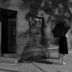 pass-by (sonyacita) Tags: street blackandwhite night umbrella sidewalk utata:project=ip179
