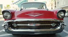 Red 1957 Chevrolet Bel Air Sedan with V-8 Engine at the Tropicana Las Vegas (scattered1) Tags: light classic logo symbol antique nevada tie bowtie front grill resort nv chrome strip bow hood headlight lasvegasstrip lasvevas