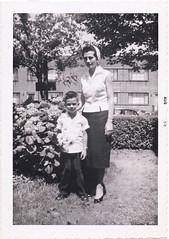 Bobby and Clara in the yard, 1958 (Robert Barone) Tags: clara newyorkcity newyork robert bronx 1950s 1958 thebronx italianamericans robertbarone