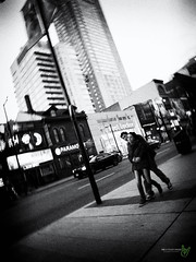 Love on Younge (Rock Steady Images) Tags: street camera original toronto ontario canada blur love car canon couple downtown grain young places equipment cameras processing handheld 200views 500views embrace 50views hipshot hirise powershots110 youngestreet 25views bypaulchambers lightroom4 rocksteadyimages