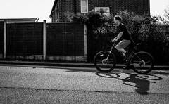 2017_85 (explored) (Chilanga Cement) Tags: fuji fujix100f x100t xseries x100s x100 x100f bw blackandwhite monochrome street streetphotography people men boy boys bike bicycle wheel wheels hill pavement sidewalk