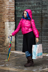'Color My World' (Canadapt) Tags: woman colour jacket umbrella bag shopping street boots rain seville spain canadapt