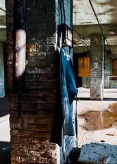 """Work Apron"" (D A Baker) Tags: tool machine shop machineshop maker fort wayne indiana ft fortwayne summer vacant decay decayporn abandoned demolished old vintage business huth history worker workman toolmaker apron denim hanging brick orange red morning sunrise puddle reflection support column"