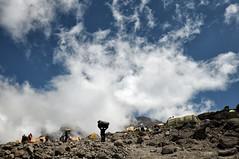 Clouds over Barafu Camp - Kilimanjaro National Park - Tanzania (PascalBo) Tags: nikon d300 tanzania tanzanie africa afrique eastafrica afriquedelest kilimanjaro kilimandjaro kilimanjaronationalpark parcnationaldukilimandjaro barafu camp campement bivouac tent outdoor outdoors rock stone lemosho hike hiking trek trekking clouds nuages expedition sky ciel people porter porteur pascalboegli