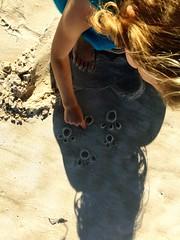 DB. DIY pawprints. Stephens Beach. South West Tasmania.