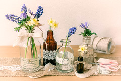 2/30: Flowers and other stuff (judi may) Tags: april2017amonthin30pictures flowers stilllife table tabletopphotography bottles lace hessian ribbon scissors string canon7d