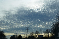 Tufted cloud skies over power lines (Monceau) Tags: clouds sky dusk indiana tufted towers transmission transmissiontower power silhouette