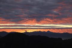 Karst Rise (Sten Rettby) Tags: karstic rock laos vang vieng asia sunrise morning dawn cloud sky landscape red shadow atmospheric optic inverted