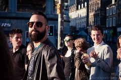 I have something in my eye (AurangzebH) Tags: edinburgh city street spring people movement passing urban light reflection glass glasses mirror