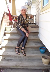 Seventy-ish Grandmotherly-Type Vainly Tries To Look 30 Years Younger (Laurette Victoria) Tags: leggings sandals silver necklace porch laurette woman