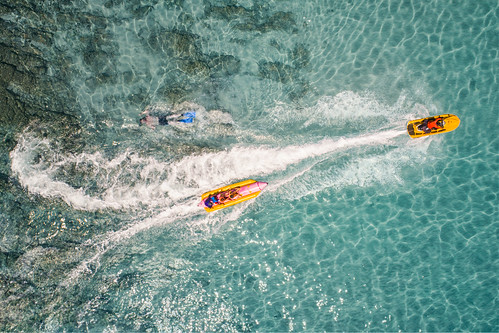 Top view of Banana boat playing and diving in Koh Larn