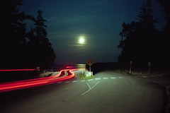 (patrickjoust) Tags: acadianationalpark mountdesertisland maine splitroad carlighttrails moon ocean sea atlatnicocean trees fujicagw690 kodakportra160 6x9 medium format 120 rangefinder 90mm f35 fujinon lens film c41 color cable release tripod long exposure night after dark manual focus analog mechanical patrick joust patrickjoust usa us united states north america estados unidos moonlight reflection full atlantic