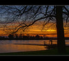 Cheer up! Soon it will be winter again.... (Wim Koopman) Tags: blue sunset orange sun holland tree castle water netherlands dutch silhouette canon reflections river landscape golden dam magic nederland powershot hour historical moment rhine waal loevestein riverscape s95