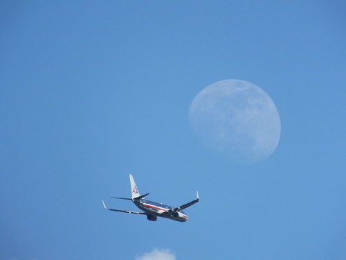 Moon and  Passenger Jet SOOC on a partly cloudy May 21, 2013 taken in Daylight with a FUJI HS50EXR DSCF0791