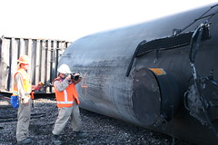 Investigators taking pictures of a derailed tank car on site in Lac-Mgantic (TSBCanada) Tags: car train tank quebec transport transportation locomotive derailed derail lacmgantic derailment mma transportationsafetyboard