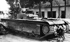 German soldiers inspecting abandoned Soviet T-35 heavy tank, near Lvov, Western Ukraine. Tank commander reported that the machine became immobile due to technical problem, all ammunition was fired and weapons removed before abandonment.