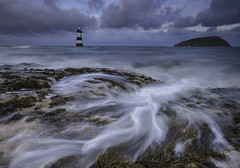 'Storm-Swell' - Black Point, Anglesey (Kristofer Williams) Tags: sunset sea lighthouse seascape wales night clouds landscape twilight rocks cloudy tide bluehour cloudscape blackpoint anglesey penmon puffinisland
