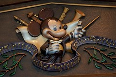 Conductor Mickey Mouse Welcomes You to... (disneyland.kid) Tags: sculpture music hongkong wooden ride disneyland mickey note mickeymouse  4d attraction conductor   hongkongdisneyland wiid   vision:sunset=0517 vision:sky=0719