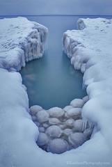 Lake Michigan ... ice balls III (Ken Scott) Tags: usa michigan shoreline january lakemichigan greatlakes icicles npp freshwater voted selfie 2014 leelanau 45thparallel iceballs kenscott manitouislands sbdnl nonposepose sleepingbeardunenationallakeshore mostbeautifulplaceinamerica bestof2014