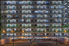 Nam Shan Estate, Hong Kong. (mikemikecat) Tags: hongkong nightscapes a7r nostalgia house mikemikecat architecture sony stacked colorful housing pattern 建築 建築物 城市 天際線 戶外 block hong kong street nightview night 夜景 香港 evening 建築大樓 vintage carlzeiss 建築結構 structures 圖案 building public fe70200mf4goss sel70200g namshanestate 南山邨 people symmetries