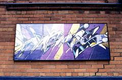 Purple Art (Bill Smith1) Tags: april2017 believeinfilm billsmithsphotography heyfsc lomographyfsquard400 nikkoro35f2lens nikkormatel toronto