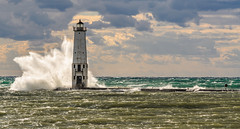 Sunlit Waters (Aaron Springer) Tags: michigan northernmichigan lakemichigan thegreatlakes frankfortlighthouse pier wave cloud breakingwave outdoor nature landscape lighthouse