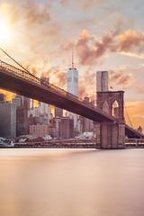 Shining Over You (Aleks Ivic) Tags: newyorkcity newyork manhattan brooklynbridge skyline cityscape sunset cloudscape clouds downtownnewyork downtownmanhattan