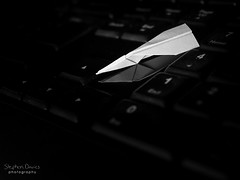 Online Flight (steved_np3) Tags: paper aeroplane airplane plane macro keyboard computer folded small reflection