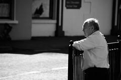 Quiet Sunday (Marta Marcato) Tags: man observe watch watching standing street streetphotography bw biancoenero uomo osservare guardare strada blackwhite nikond7200 irlanda ireland