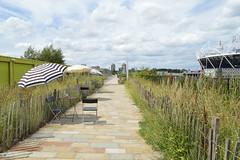 Inviting (sanat_das) Tags: london olyympicpark path tables chairs umbrellas landscape emptyseats d3200 1855mm