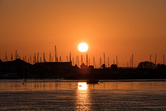 Sunset from Deganwy (dilys_thompson) Tags: deganwy sunset sun boats marina water northwales reflection orange sky redskyatnight