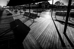 Boardwalk (Nora Kaszuba) Tags: blackwhite boardwalk oceanbeach newlondonconnecticut lightsandshadows fuji16mmf14 fujixt2 norakaszuba benches