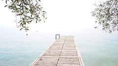 Lake view (carlopiva) Tags: sony sonya6000 sonyalfa sea water gardalake lagodigarda lake fog nebbia pontile