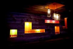 hernando's hideaway (milomingo) Tags: saguarohotel scottsdale arizona southwest resort dark light contrast purple lamp lighting bottle glass geometry wood wooden plank board beam motif design lounge multicolored abstract