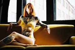 Dasha (val_lytko) Tags: girl light film tattoo tattoos 135film 35mm 35mmfilm leralytko window ukraine sun sunset swimwear crochet couch yellow canon5 canon colour kodak portrait portra
