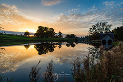 sunset over Carton House (Pastel Frames Photography) Tags: sunset ireland lake reflections trees travel travelphotography sky clouds canon5dmark3 kildare landscape landscapephotography cartonhouse maynooth canon 2470mm nature sightseeing beauty boat house grass sun autumn