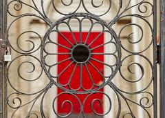 Swirly and Red (Darren LoPrinzi) Tags: red metal canon fence cool rust gate iron dof bokeh lock depthoffield uncool cool2 cool5 cool3 cool6 cool4 cool7 canoneos7d canon7d iceboxcool darrenlo