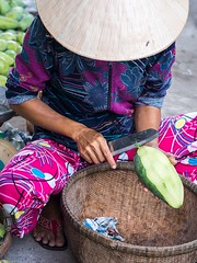 Peeling mango (Miha Pavlin) Tags: trip vacation se asia peeling vietnam adventure mango southeast doc indochina chau