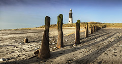 Sunlight and long shadows at Spurn Point (Katybun of Beverley) Tags: lighthouse coast sand rocks shadows pebbles coastline groynes eastyorkshire spurnpoint spurnhead kilnsea yorkshirecoast spurnheadnationalnaturereserve
