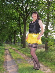 Fighting the wind (Paula Satijn) Tags: sexy hot girl skirt miniskirt satin silk silky shiny yellow gurl tgirl black outside tree spring smile fun joy happy legs stockings lace stockingtops lacy sensual