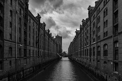 Speicherstadt (öppel) Tags: hamburg speicherstadt storehouse city town germany deutschland old warehouse district alster elbe binnenalster north sea northsea nordsee market trade trading historic architecture nikon d7100 sigma 1770mm contemporary black white grey monochrome outside outdoor stormy windy cloudy clouds photo schiff ship boat möwe gull seagull