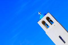 Bell tower in Santorini (Nicolay Abril) Tags: cicladas islascicladas egeo maregeo grecia santorini cyclades cycladesislands aegean aegeansea greece egée meregée grèce santorin ελληνικά κυκλάδεσ αιγαίοπέλαγοσ αιγαίο ελλάδα σαντορίνη kykladeninseln ägäis griechenland kykladen cicladi isolecicladi islasgriegas ελληνικάνησιά greekislands yunanadaları griechischeinseln stgerasimoschristianchurch saintgerasimoschristianchurch καμπαναριό belltower campanario campanile sky bluesky ουρανού μπλετουουρανού ciel cielbleu bleu blanc blue white blanco azul μπλε άσπρο σύννεφα εκκλησία iglesia church cruz croix cross σταυρόσ mediterraneo mediterranean mediterranée μεσόγειοσ