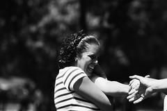 (Aaron Montilla) Tags: aaronmontilla 2013 blackwhite woman maturewoman happyness dancing portrait femme female femaleportrait sexy sensuality outdoors parquedeleste mujer mujermadura felicidad baile retrato femina retratofemenino sensualidad exteriores canonrebel eos 75300 iso200 230mm f50 1250 blancoynegro bw byn lines lineasblancas cotton algodon tshirt franela earing arete brownhair curlyhair cabellocastaño rulos hazeleyes ojoscastaños nose nariz teeth dientes hands manos streetphotography fotografiacallejera documentaryphoto fotografiadocumental internationalflickrawards composicion composition monochrome