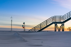 The Windmill and the Staircase (redfurwolf) Tags: southpole antarctica icecubelab windmill stairs staircase sky clouds sunset goldenhour snow ice outdoor flag blue orange redfurwolf sonyalpha sony a99ii sal1635f28za abstract simple simplicity