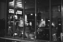 (B&W of Fantasma A slide) Through a pub window from the sidewalk near the railway station in King street Newtown NSW at night - Autumn 2017(BW) (nicephotog) Tags: nightonearth fantasma ghost pub window reflection public sidewalk drinking entertainment newtown sydney nsw