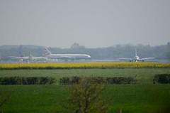 In the sun (smcnally24601) Tags: spring england britain aircraft plane british airways boeing 777 runway heat haze shimmer