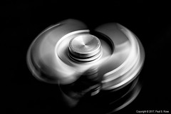 Macro Monday - Intentional Blur (roseysnapper) Tags: bw intentionalblur macromonday niksoftware nikkor105mmf28 nikond810 silverefexpro20 blackandwhite blackbackground closeup naturallight windowlight lightroom macro photoshop fidget monochrome spinning toy